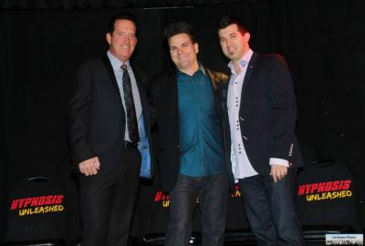 Vegas Hypnotists Anthony Cools and Marc Savard congratulate Kevin Lepine